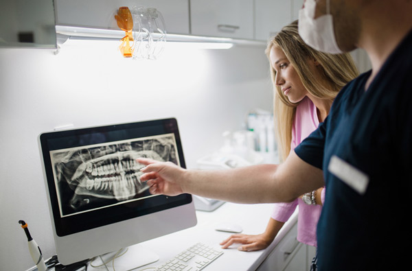 Dentist reviewing a digital xray